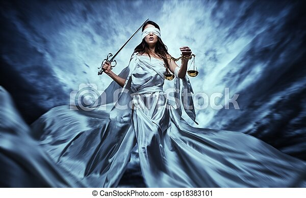 Femida, Goddess of Justice, with scales and sword wearing blindfold against dramatic stormy sky - csp18383101
