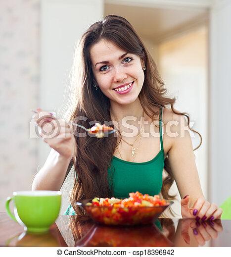 beautiful woman eating veggie salad  - csp18396942