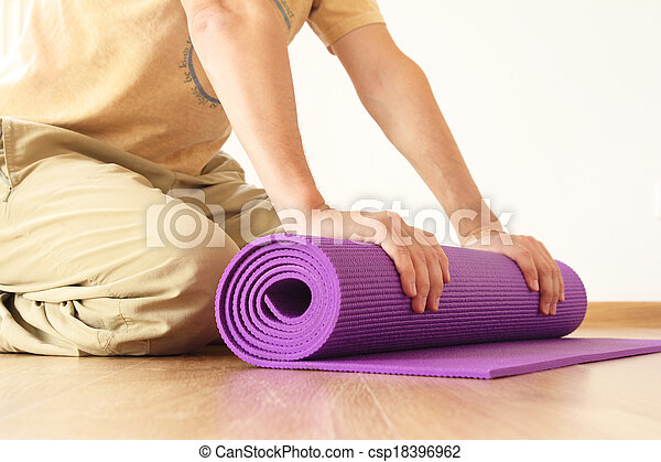 man with yoga mat - csp18396962