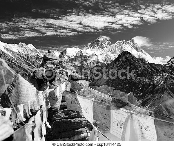 Black and white view of everest from gokyo ri with prayer flags and clouds - Nepal  - csp18414425