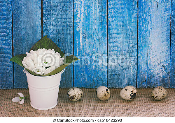 Easter  background with eggs and snowdrops - csp18423290
