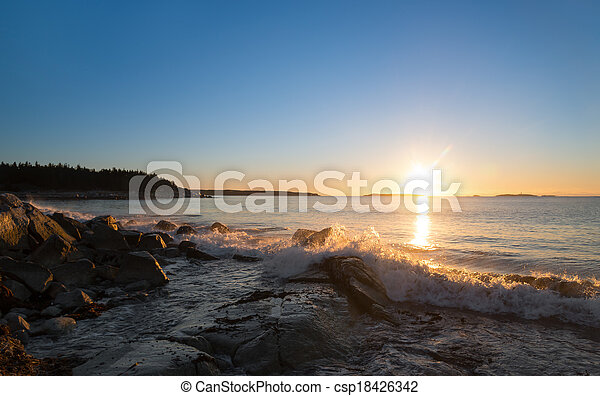 Winter sunrise at the ocean beach - csp18426342