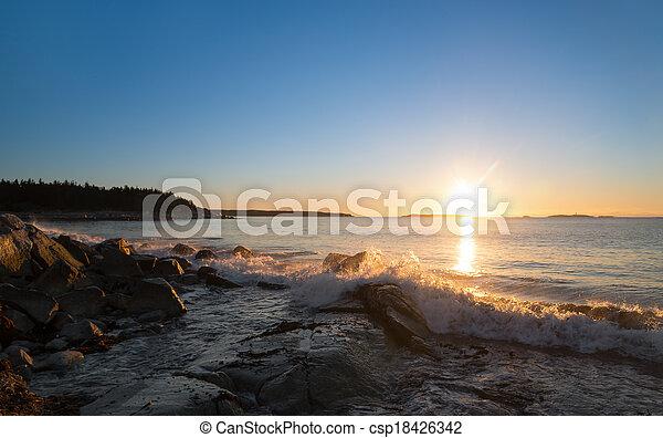 Winter sunrise at the ocean beach - csp18426342