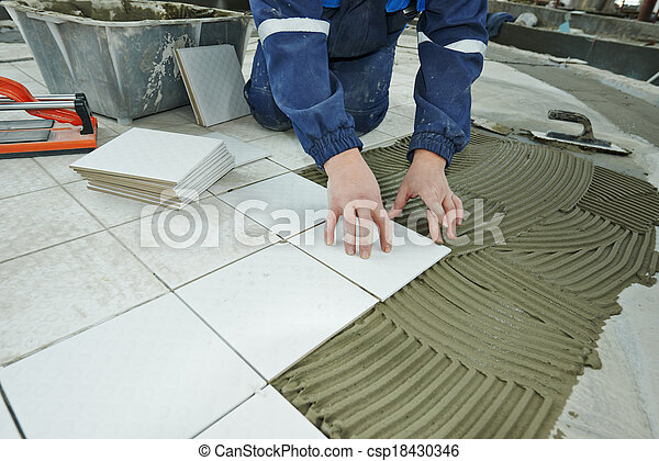 tilers at industrial floor tiling renovation - csp18430346