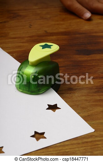 Green punching machine for paper scrapbooking - csp18447771