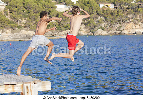 summer camp kids jumping in sea - csp18480200