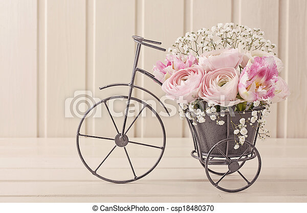 Picture of Ranunculus flowers in a bicycle vase