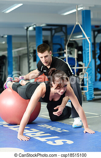 Press ups on gym ball with personal trainer - csp18515100