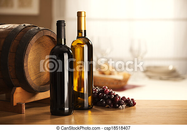 Selection of red and white wine with restaurant on background.