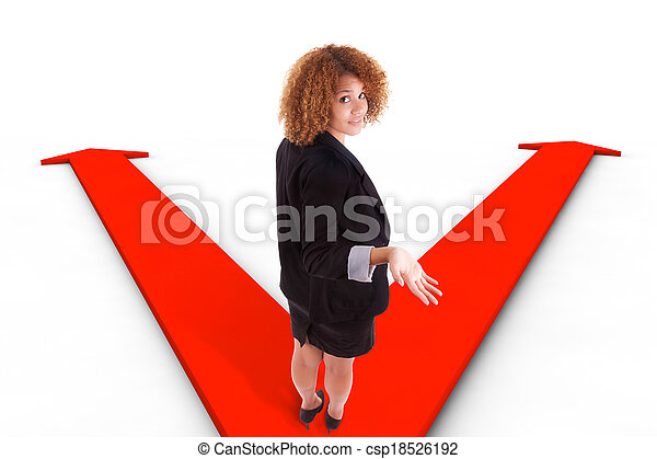African american business woman hesitating between two ways indicated by arrows - csp18526192