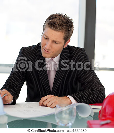 young engineer looking at blueprints - csp1854230