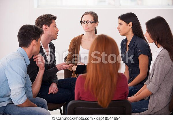 Group therapy. Group of people sitting close to each other and communicating - csp18544694