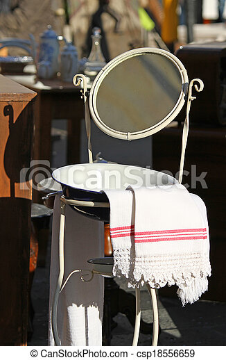 Washbasin with basin and ancient mirror of a farmhouse