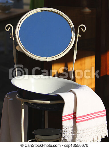 Washbasin with basin and ancient mirror of a farmhouse for sale
