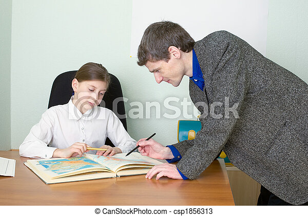 Tutor and schoolgirl with atlas - csp1856313