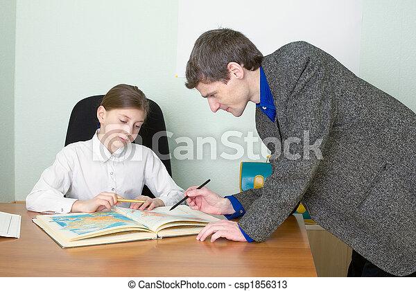 Tutor and schoolgirl with atlas - csp1856313
