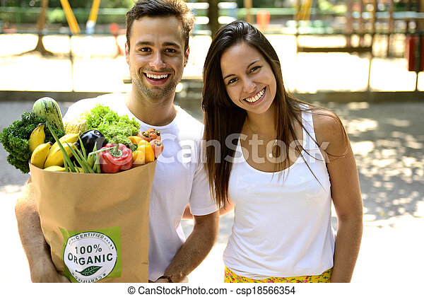 Couple with bag organic vegetables - csp18566354