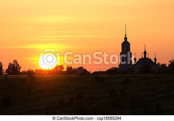 Silhouette of church against a sunset - csp18585294