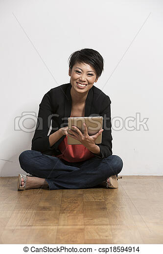 Chinese woman sitting with a Digital Tablet