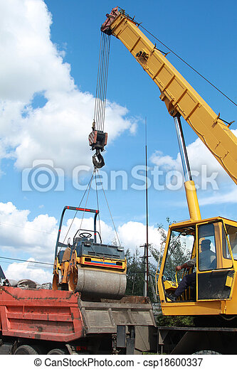 Loading compactor on the transportation machine using a crane - csp18600337