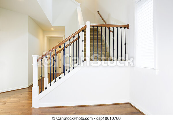 Residential Home with Woodend Floors and Custom Staircase - csp18610760