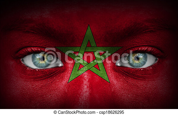 Human face painted with flag of Morocco - csp18626295