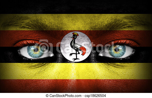 Human face painted with flag of Uganda - csp18626504