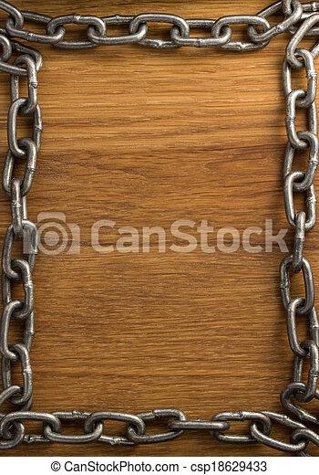 metal chain on wood