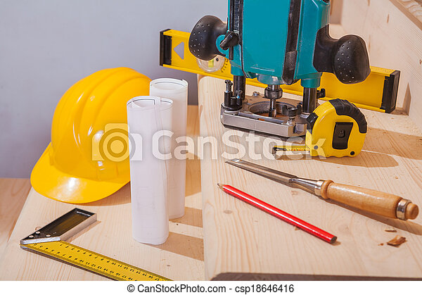 view on set of carpentry tools on steps of wooden ladder - csp18646416