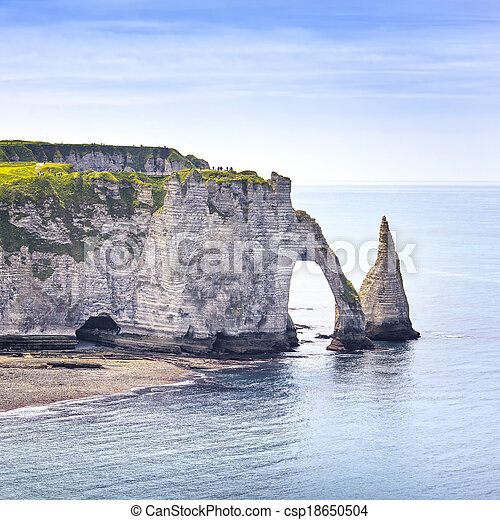 Etretat Aval cliff, rocks and natural arch landmark and blue ocean. Aerial view. Normandy, France, Europe. - csp18650504