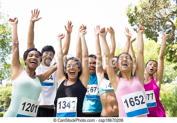 Marathon runners cheering in park - csp18670206