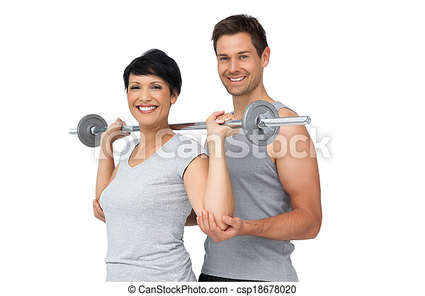 Personal trainer helping woman with weight lifting bar - csp18678020