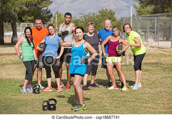 Cute Woman Posing with Fitness Group - csp18687741