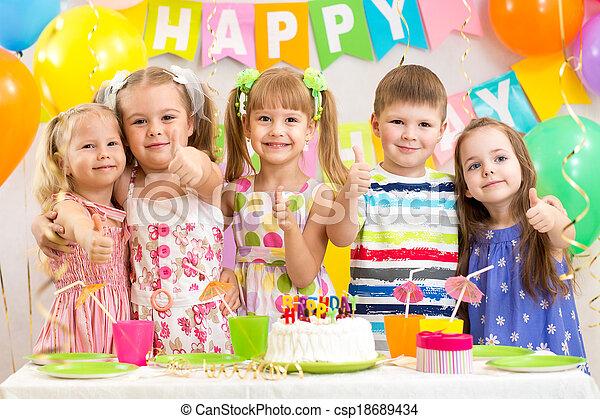 kids preschoolers celebrating birthday party - csp18689434