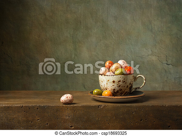 Still life with chocolate easter eggs - csp18693325