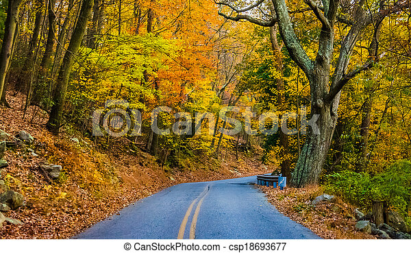 Autumn color along a road at Pen Mar County Park, Maryland. - csp18693677