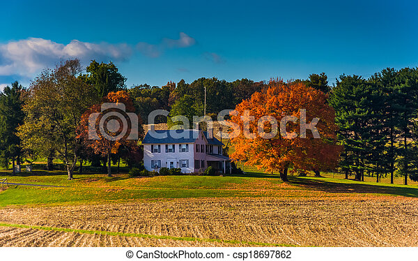 House and autumn colors in rural York County, Pennsylvania. - csp18697862