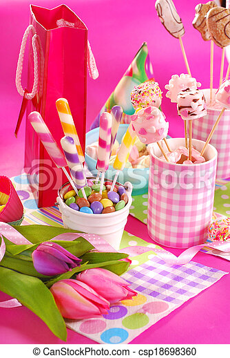 birthday party table with flowers and sweets  for kids - csp18698360