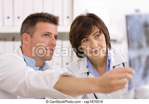 Doctors looking at x-ray image - csp1870016