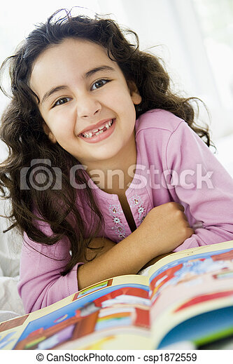 A Middle Eastern girl reading a book - csp1872559