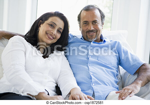 A Middle Eastern couple sitting at home - csp1872581