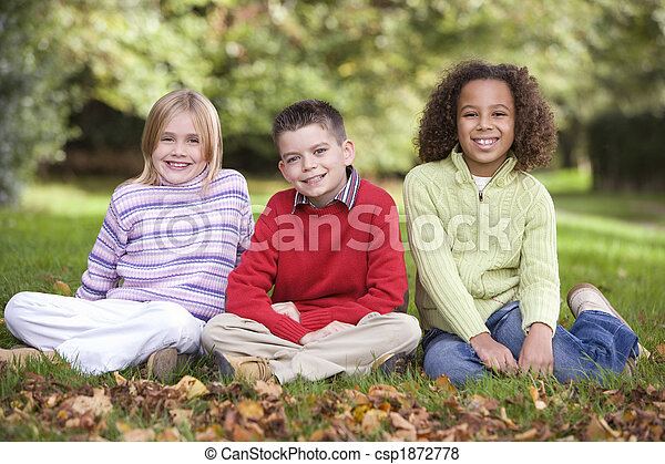 Group of children sitting in garden - csp1872778