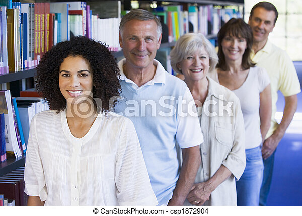 Adult students standing in a library - csp1872904