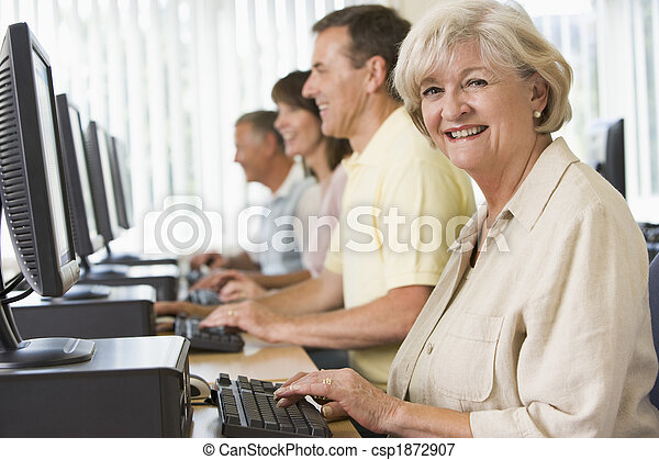 Adult students in a computer lab - csp1872907