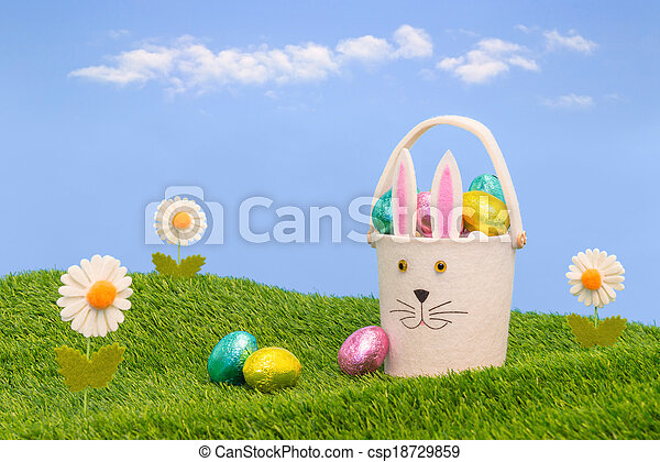 Easter basket full of chocolate eggs. - csp18729859