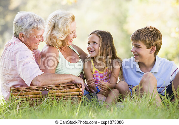 Grandparents having a picnic with grandchildren - csp1873086