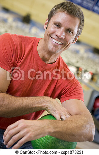 Portrait of a young man holding a bowling ball  - csp1873231