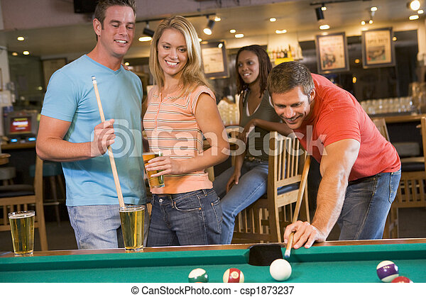 Young adults playing pool in a bar - csp1873237