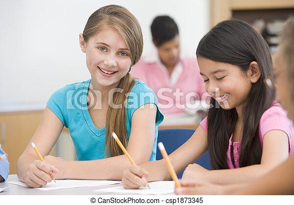 Elementary school pupils in classroom - csp1873345