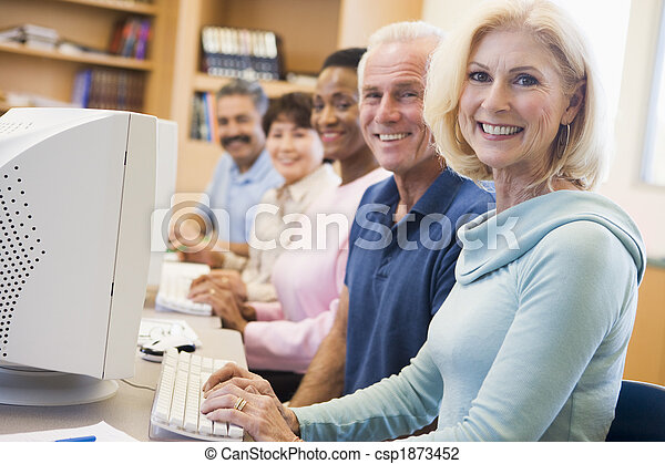 Mature students learning computer skills - csp1873452